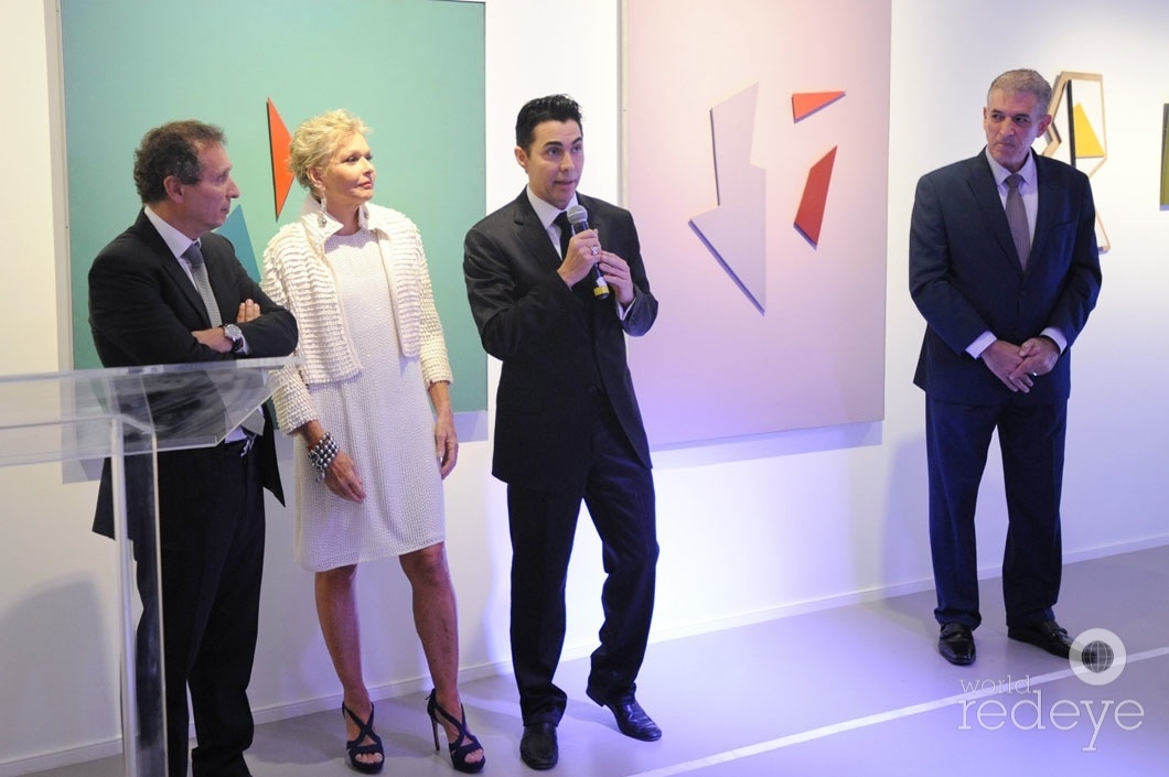 Daniel Maman, Irene Zingg, Nicolas Felizola speaking, & John Arena